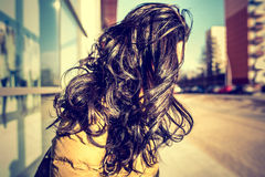 Brunette girl with long curly hair outdoor Stock Photography