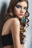 Brunette girl with long hair and creative makeup Royalty Free Stock Images