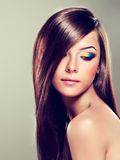 Brunette girl with long straight hair. Stock Images