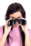 Brunette girl looking through binoculars Stock Photos