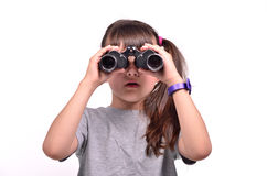 Brunette girl looking through binoculars Stock Images