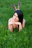 Brunette girl lying on grass. Stock Images