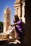 Brunette girl in a medieval suit in a Agia Napa Medieval Monaste Royalty Free Stock Photos