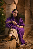 Brunette girl in a medieval suit in a Agia Napa Medieval Monaste Royalty Free Stock Images