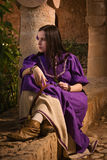 Brunette girl in a medieval suit in a Agia Napa Medieval Monaste Stock Image