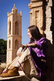 Brunette girl in a medieval suit in a Agia Napa Medieval Monaste Stock Photos