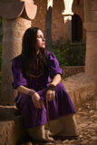 Brunette girl in a medieval suit in a Agia Napa Medieval Monaste Stock Photo