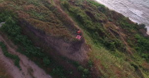 Brunette girl meditating at the seaside stock footage