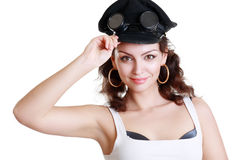 Brunette girl in a military cap Stock Photos