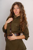 Brunette girl in military clothes Royalty Free Stock Photography