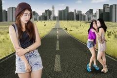 Brunette girl mocked by her friends Stock Image