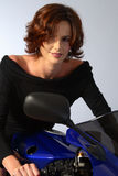 Brunette girl on motorcycle black dress Royalty Free Stock Images