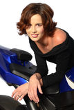 Brunette girl on motorcycle black dress Royalty Free Stock Photo