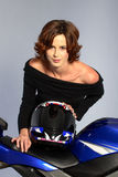 Brunette girl on motorcycle black dress and helmet Stock Photos