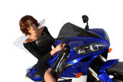 Brunette girl on motorcycle black dress and wings Royalty Free Stock Photography