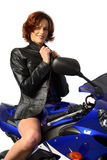 Brunette girl on motorcycle leather jacket Stock Image