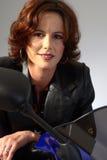 Brunette girl on motorcycle leather jacket Royalty Free Stock Photo