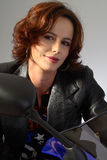 Brunette girl on motorcycle leather jacket Royalty Free Stock Photography