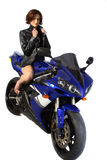 Brunette girl on motorcycle leather jacket Stock Photography