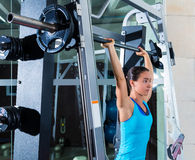 Brunette girl in multipower barbell at gym smith Royalty Free Stock Photography