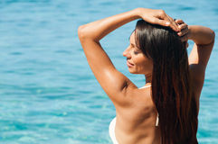 Brunette girl near the sea. Royalty Free Stock Image