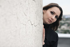 Brunette girl near wall Royalty Free Stock Images