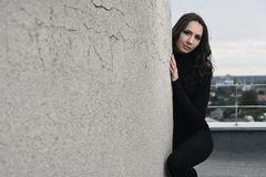 Brunette girl near wall Stock Photography