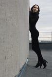 Brunette girl near wall Stock Photos