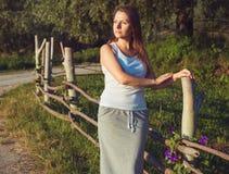 Brunette girl outdoors summer day Stock Images