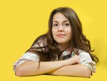 Brunette girl over yellow Royalty Free Stock Photos