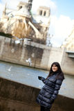 Brunette girl at Parisian embankment Royalty Free Stock Image
