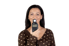 Brunette girl with a photometer Stock Images
