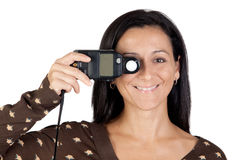 Brunette girl with a photometer Royalty Free Stock Photo