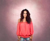 Brunette girl with a pink sensual shirt Stock Images