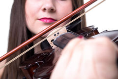 Brunette girl playing on fiddle, close up Stock Photography
