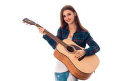 Brunette girl playing guitar and smiling on camera. Cheerful Brunette girl playing guitar and smiling on camera isolated on white background Stock Photography