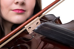 Brunette girl playing on violin, close up Stock Photos