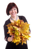 Brunette girl plays with garland of yellow leaves Stock Photos