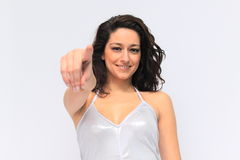 Brunette girl pointing Royalty Free Stock Images
