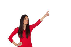 Brunette girl pointing something with her finger Royalty Free Stock Image