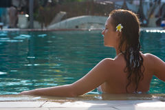 Brunette girl in the pool Stock Photography