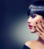 Brunette Girl Portrait. Beautiful Brunette Girl Portrait. Face. Makeup. Sensual Red Lips Stock Image