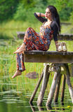 Brunette girl portrait in outdoor scenery Royalty Free Stock Photography