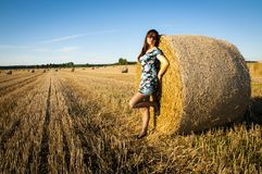 Brunette girl portrait and straw bale Stock Photo
