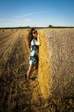 Brunette girl portrait and straw bale Royalty Free Stock Image