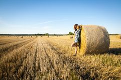 Brunette girl portrait and straw bale Stock Photos