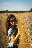 Brunette girl portrait and straw bale Royalty Free Stock Photos