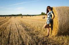 Brunette girl portrait and straw bale Royalty Free Stock Photography