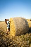 Brunette girl portrait and straw bale Royalty Free Stock Photo
