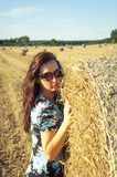 Brunette girl portrait and straw bale Royalty Free Stock Images